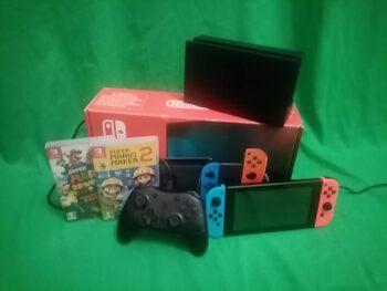Nintendo Switch + Manette Pro & Deux Jeux Mario sur nintendo switch.
