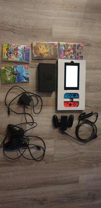 Switch + manette usb + 4 jeux (mario et lapins cretins, zelda botw, mariokart 8)